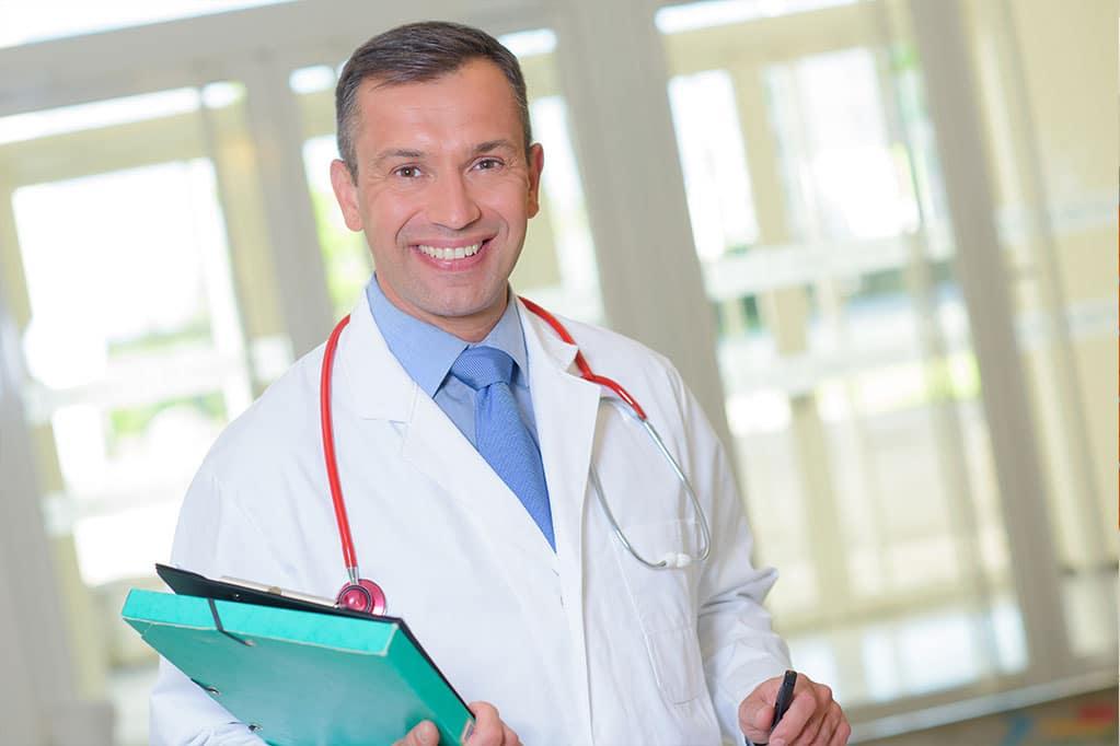 Male dentist smiling
