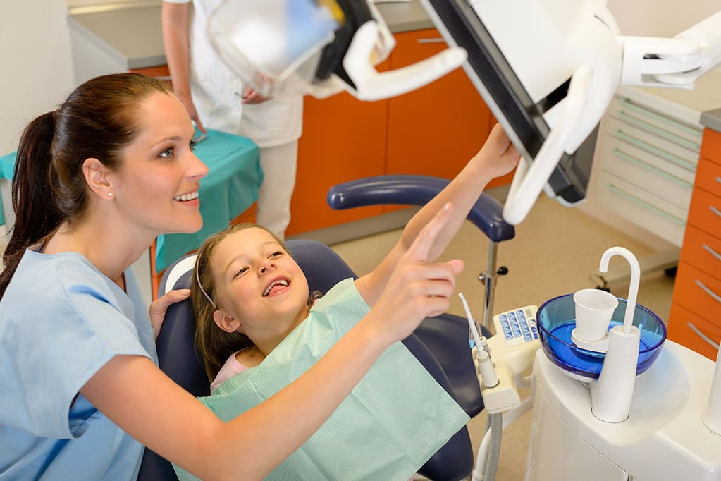 Child with dentist smiling